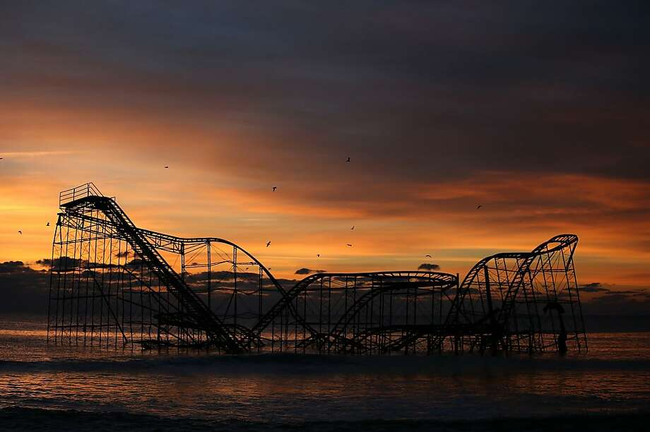 SEASIDE HEIGHTS, NJ - NOVEMBER 25:  A roller coaster sits in the ocean after the Casino Pier collapsed when Superstorm Sandy hit, on November 25, 2012 in Seaside Heights, New Jersey. Mayor Bill Akers has asked the Coast Guard to find out whether the coaster is structurally stable, adding that it would make a great tourist attraction.  (Photo by Mark Wilson/Getty Images) Photo: Mark Wilson, Getty Images
