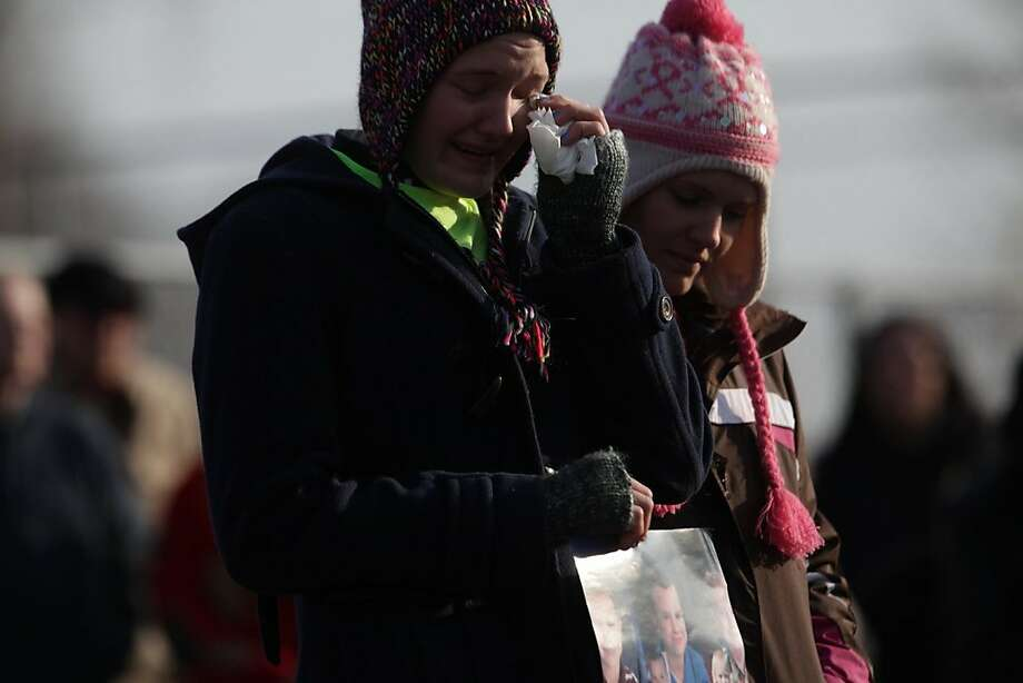 Courtney Derby, 24, left gets emotional as she tells a story Sunday, Nov. 25, 2012 in Morenci, Mich., about her three missing brothers, Andrew, Alexander, and Tanner Skelton who were 9, 7 and 5, respectively, when they went missing in November 2010. Supporting her on the right is her sister Brittany Crowel, 21. Over a hundred people gathered at Wakefield Park in Morenci to raise awareness and remember the boys on Sunday Nov. 25, 2012. Following the unveiling people gathered at the Morenci Fire Station to decorate ornaments for trees, refreshments and a bake sale fundraiser. (AP Photo/Detroit Free Press, Romain Blanquart) Photo: Romain Blanquart, Associated Press