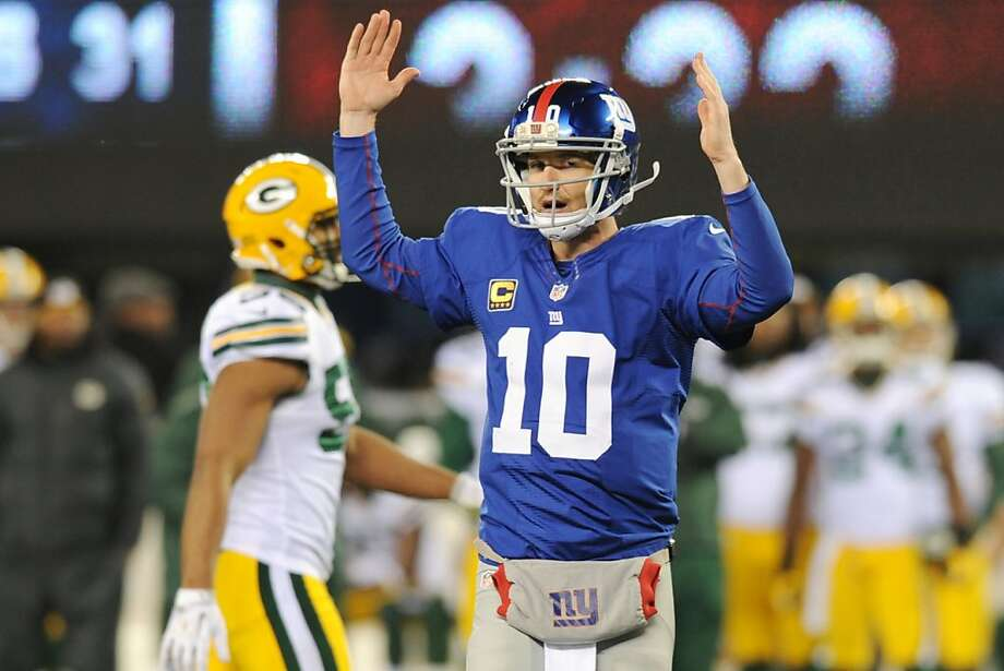 Giants quarterback Eli Manning pauses to celebrate his third touchdown pass of the night - and 200th of his career - after hitting Hakeem Nicks with a 13-yard strike over the middle. Photo: Bill Kostroun, Associated Press