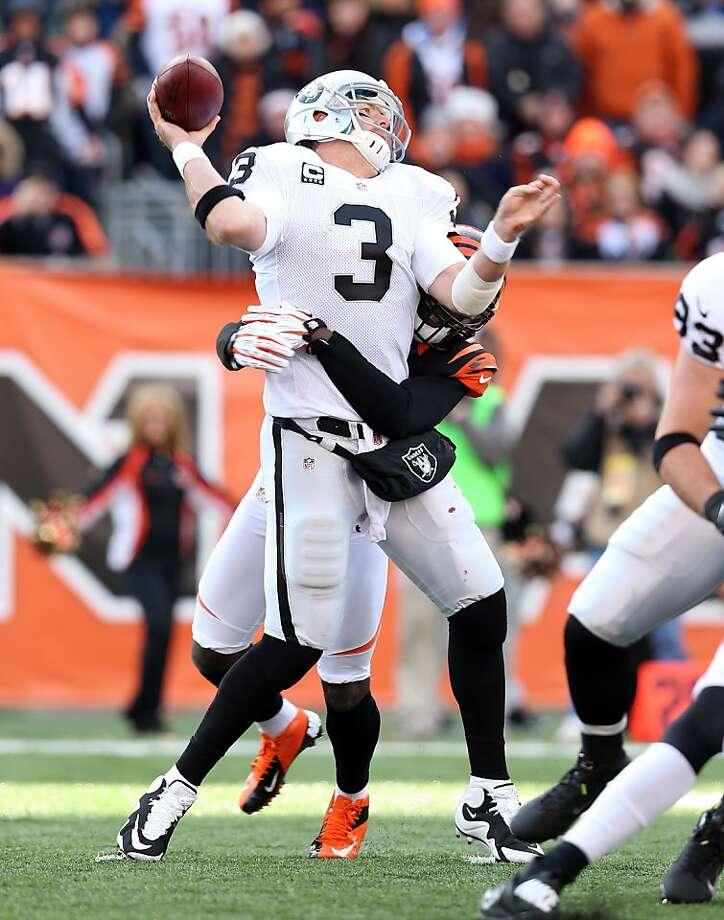 CINCINNATI, OH - NOVEMBER 25:  Carson Palmer #3 of the Oakland Raiders is hit by Reggie Nelson #20 of the Cincinnati Bengals as he throws a pass during the NFL game at Paul Brown Stadium on November 25, 2012 in Cincinnati, Ohio.  (Photo by Andy Lyons/Getty Images) Photo: Andy Lyons, Getty Images