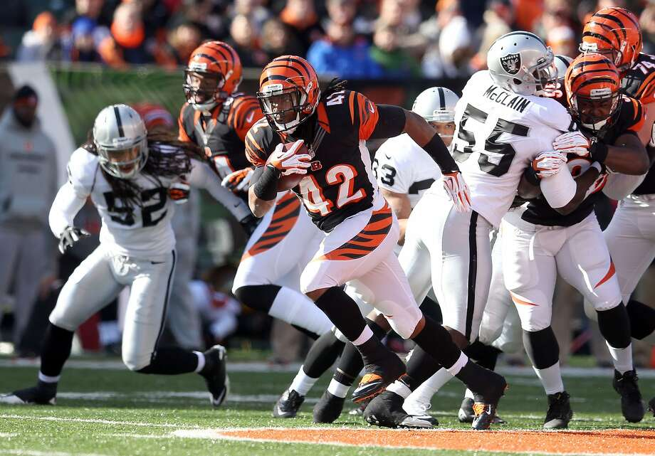 CINCINNATI, OH - NOVEMBER 25:  BenJarvus Green-Ellis #42 of the Cincinnati Bengals runs with the ball during the NFL game against the Oakland Raiders at Paul Brown Stadium on November 25, 2012 in Cincinnati, Ohio.  (Photo by Andy Lyons/Getty Images) Photo: Andy Lyons, Getty Images