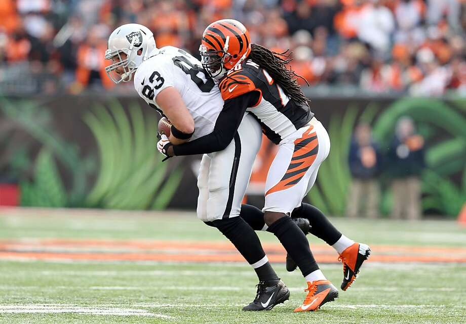 CINCINNATI, OH - NOVEMBER 25:  Brandon Myers #83 of the Oakland Raiders is tackled by Reggie Nelson #20 of the Cincinnati Bengals during the NFL game at Paul Brown Stadium on November 25, 2012 in Cincinnati, Ohio.  (Photo by Andy Lyons/Getty Images) Photo: Andy Lyons, Getty Images