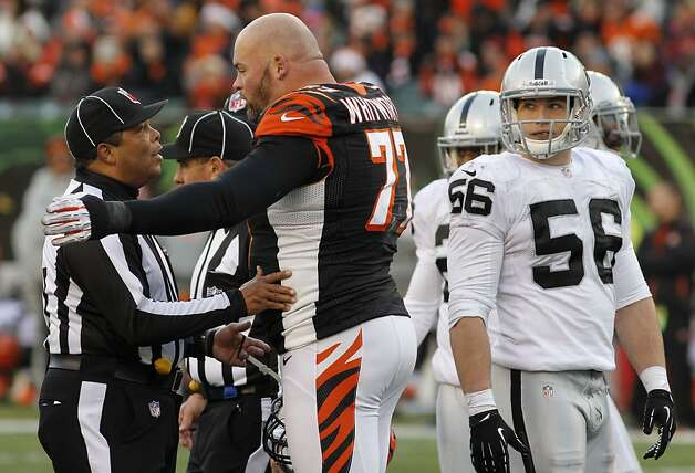 Cincinnati Bengals tackle Andrew Whitworth (77) argues with an official while Oakland Raiders outside linebacker Miles Burris (56) listens in the second half of an NFL football game, Sunday, Nov. 25, 2012, in Cincinnati. (AP Photo/Tom Uhlman) Photo: Tom Uhlman, Associated Press