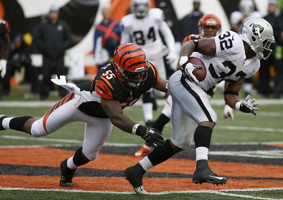 Oakland Raiders fullback Jeremy Stewart (32) is tackled by Cincinnati Bengals outside linebacker Vontaze Burfict (55) in the second half of an NFL football game, Sunday, Nov. 25, 2012, in Cincinnati. (AP Photo/David Kohl) Photo: David Kohl, Associated Press