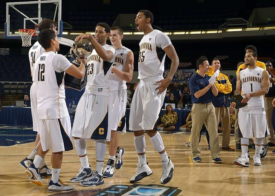 California team members celebrate with their trophy after defeating Pacific their NCAA college basketball game at the DirecTV Classic final, Sunday, Nov. 25, 2012, in Anaheim, Calif. California won 78-58. (AP Photo/Mark J. Terrill) Photo: Mark J. Terrill, Associated Press