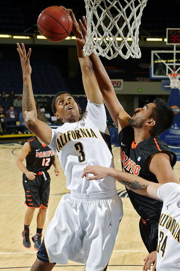 California's Tyrone Wallace, left, grabs a rebound away from Pacific's Tony Gill during the first half of their NCAA college basketball game at the DirecTV Classic final, Sunday, Nov. 25, 2012, in Anaheim, Calif. (AP Photo/Mark J. Terrill) Photo: Mark J. Terrill, Associated Press