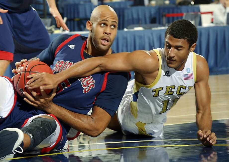 Saint Mary's Kyle Rowley, left, and Georgia Tech's Chris Bolden battle for a loose ball during the first half of their NCAA college basketball game at the DirecTV Classic, Sunday, Nov. 25, 2012, in Anaheim, Calif. (AP Photo/Mark J. Terrill) Photo: Mark J. Terrill, Associated Press