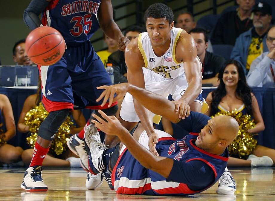 Saint Mary's Kyle Rowley, bottom, and Georgia Tech's Chris Bolden battle for a loose ball during the first half of their NCAA college basketball game at the DirecTV Classic, Sunday, Nov. 25, 2012, in Anaheim, Calif. (AP Photo/Mark J. Terrill) Photo: Mark J. Terrill, Associated Press