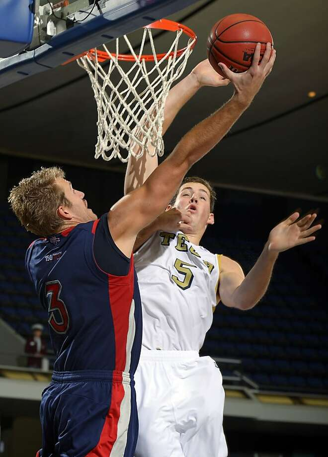 Saint Mary's Mitchell Young, left, shoots as Georgia Tech's Daniel Miller (5) defends during the second half of their NCAA college basketball game at the DirecTV Classic, Sunday, Nov. 25, 2012, in Anaheim, Calif. Georgia Tech won 65-56. (AP Photo/Mark J. Terrill) Photo: Mark J. Terrill, Associated Press