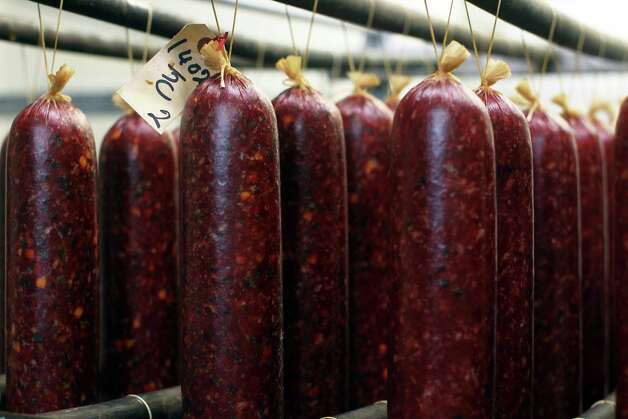 Venison sausage hangs in the processing room at Eddie's Game Processing, Sunday, November 18, 2012. Photo: JENNIFER WHITNEY / © Jennifer Whitney