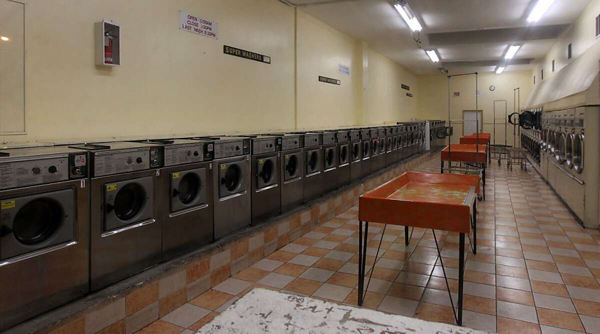 A man passes the Laundromat on Silver Ave in San Francisco that was the scene of a Zebra gang murder of Jany Holly on Jan. 28, 1974 as she loaded clothes into a dryer, she was shot in the back. photo taken Saturday August 21, 2012. In San Francisco California.