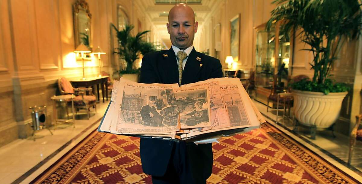 Palace Hotel employee Jose Lopez holds a scrapbook of newspaper clippings on President Harding's visit. President Warren Harding passed away under what some called mysterious circumstances at the Palace Hotel August 2, 1923. Photo taken September 14, 2012 in presidential suite of the hotel in San Francisco California.