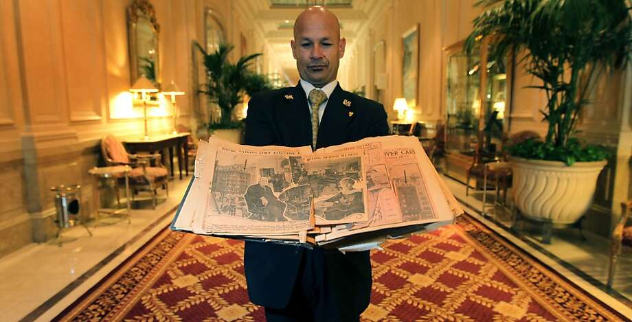 Palace Hotel employee Jose Lopez displays a scrapbook of clippings about President Harding's ill-fated 1923 stay. Harding died in the presidential suite. Photo: Lance Iversen, The Chronicle