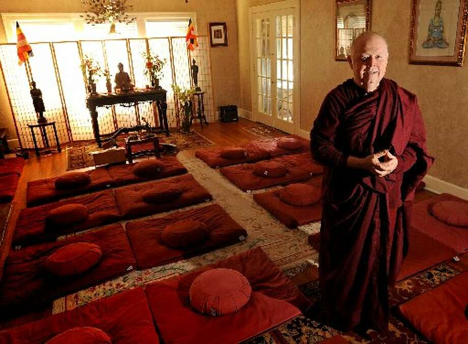 Bhante Kassapa stands in the meditation room at Metta House.