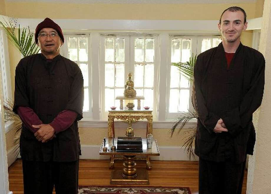 Santi Karo, left, and Ananda stand in an upstairs room at Metta House.
