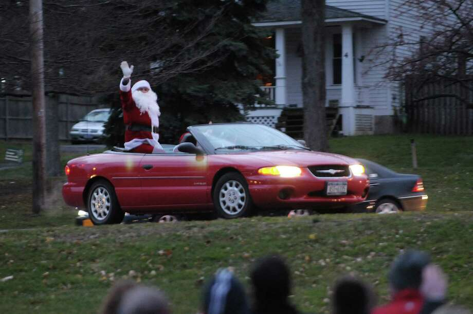 Santa Claus arrives in a convertible during the annual tree lighting at Loudon Green on Sunday, Nov. 25, 2012 in Loudonville, NY.  The event is hosted by the Greater Loudonville Association.  (Paul Buckowski / Times Union) Photo: Paul Buckowski