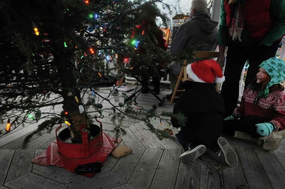 Mason Perry, left, 6, and Sara Oakley, 6, both from Loudonville flip the switch to light up the tree during the annual tree lighting at Loudon Green on Sunday, Nov. 25, 2012 in Loudonville, NY.  The event is hosted by the Greater Loudonville Association.  (Paul Buckowski / Times Union) Photo: Paul Buckowski