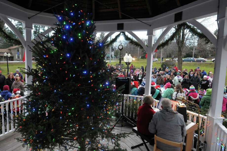 Families sing Christmas songs during the annual tree lighting at Loudon Green on Sunday, Nov. 25, 2012 in Loudonville, NY.  The event is hosted by the Greater Loudonville Association.  (Paul Buckowski / Times Union) Photo: Paul Buckowski