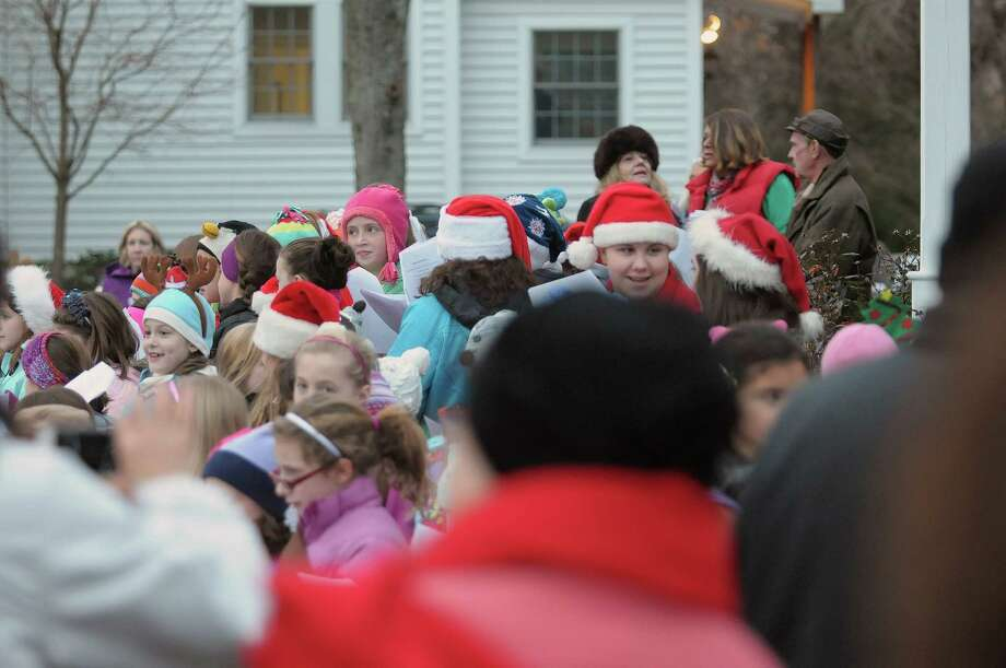 Girls in daisies, brownies, and girl scouts along with boys in the cub scouts from area schools, lead the singing of Christmas songs during the annual tree lighting at Loudon Green on Sunday, Nov. 25, 2012 in Loudonville, NY.  The event is hosted by the Greater Loudonville Association.  (Paul Buckowski / Times Union) Photo: Paul Buckowski  / 00020072A