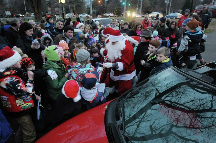 Children swarm around Santa Claus as he hands out candy canes  during the annual tree lighting at Loudon Green on Sunday, Nov. 25, 2012 in Loudonville, NY.  The event is hosted by the Greater Loudonville Association.  (Paul Buckowski / Times Union) Photo: Paul Buckowski