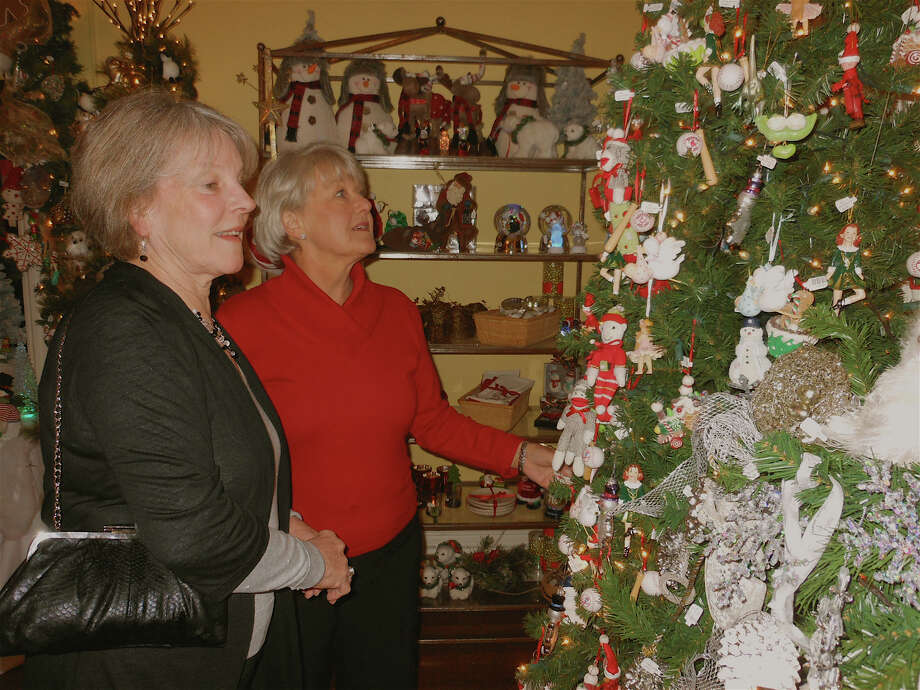 At last year's Christmass Tree Festival, Fairfielders Susan Burns and Linda Lanzo look at ornaments in the Holiday Boutique room at the Burr Homestead. Photo: Mike Lauterborn / Fairfield Citizen contributed