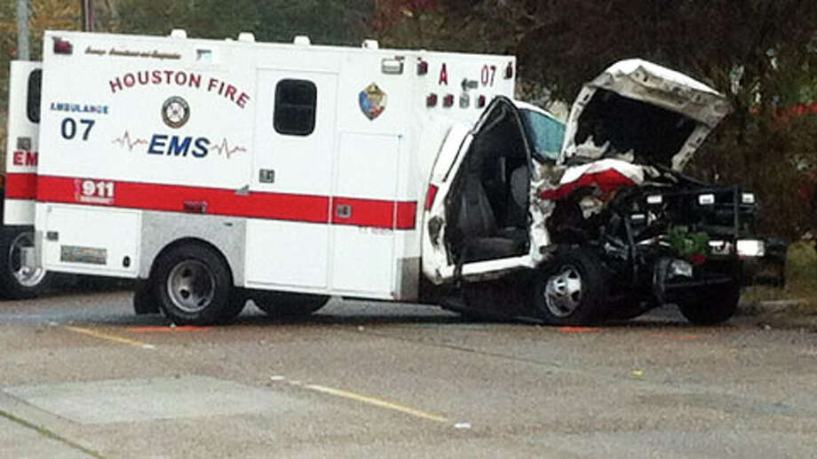 Houston police are trying to determine what led an SUV driver to slam  into an HFD ambulance about 4:30 a.m. Monday in the 2400 block of Holman  near St. Charles just south of downtown. (Cody Duty / Houston Chronicle)