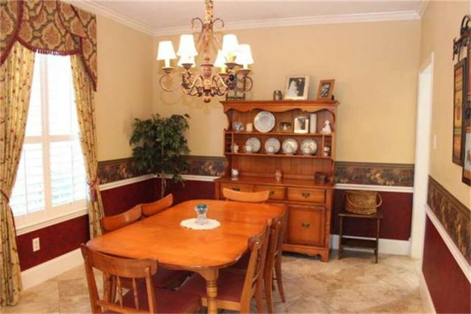 The dining room provides a cozy space for formal dining. Photo: RE/ Max Westside