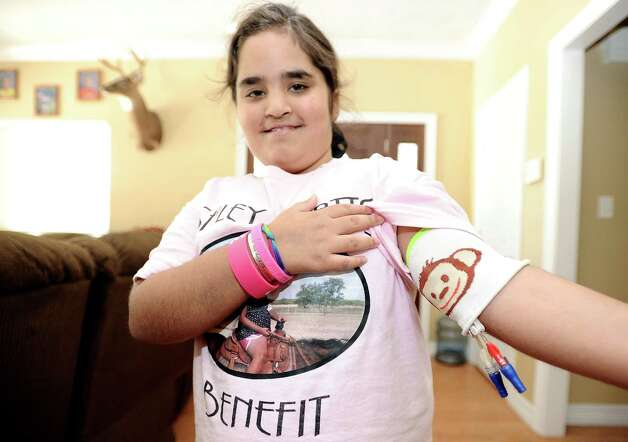Nederland resident Ashley Watts, 10,  will have a benefit held for her on Sunday to raise money and awareness for Watts'  condition and her much needed bone marrow transplant. Photo taken: Randy Edwards/The Enterprise Photo: Randy Edwards