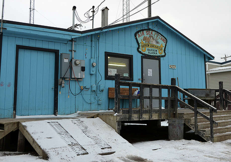 A volunteer corps of Alaskans staffs a search and rescue operation in Barrow, Alaska. This is their headquarters. Aside from the radio equipment and desk inside, the space also functions as a community center for many Native Alaskans who play cards, watch television, sip coffee and chat with friends here. (Jennifer A. Dlouhy / The Houston Chronicle)