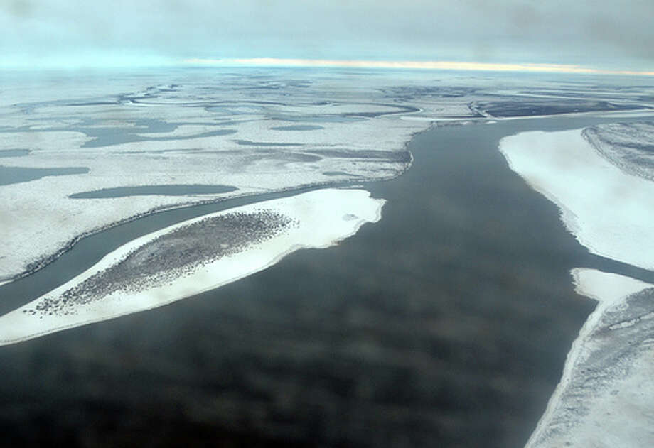 Waterways of the snow-covered North Slope, as seen from a dirty plane window in early October 2012. (Jennifer A. Dlouhy / The Houston Chronicle)