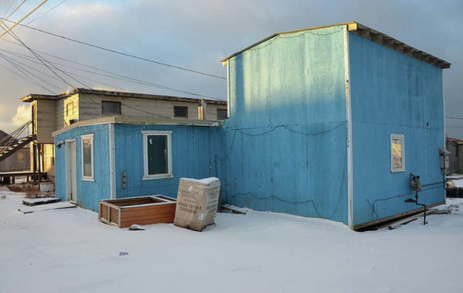 Many wooden houses in Barrow, Alaska are painted with bright colors, making them stand out against the white, snow-covered landscape. (Jennifer A. Dlouhy / The Houston Chronicle)