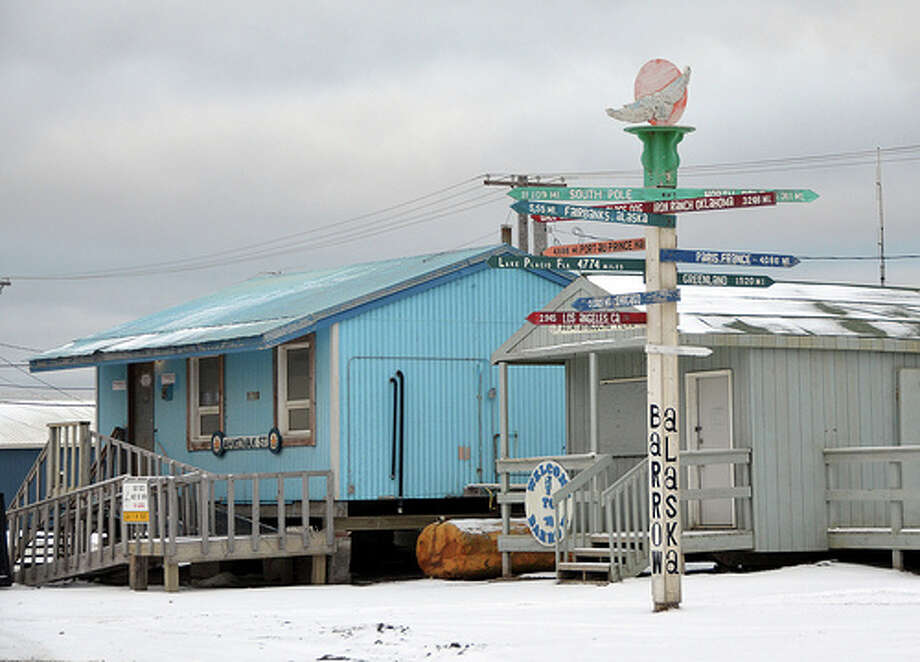 A novelty sign highlights the distance and direction from Barrow, Alaska -- the United States' northernmost city -- to far-flung destinations around the world. (Jennifer A. Dlouhy / The Houston Chronicle)