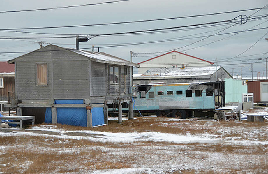Buildings and vehicles in Barrow, Alaska. (Jennifer A. Dlouhy / The Houston Chronicle)