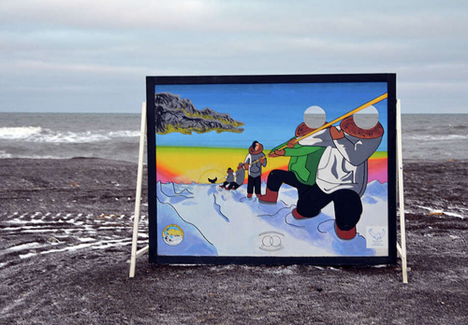 Visitors can put themselves in a colorful scene courtesy of this sign on an otherwise grey beach in Barrow, Alaska. (Jennifer A. Dlouhy / The Houston Chronicle)