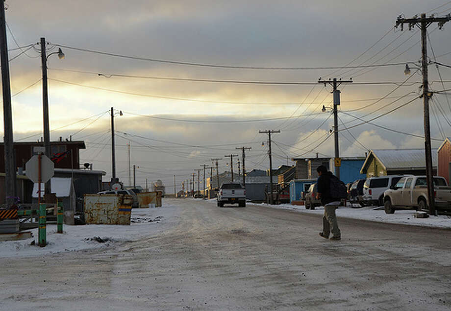 A student walks across a road in Barrow, Alaska. (Jennifer A. Dlouhy / The Houston Chronicle)