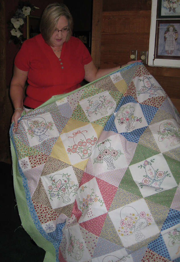 Debbie Long, a Sour Lake resident, shows off one of her many quilts.  Photo taken  Ioanna Makris/The Enterprise