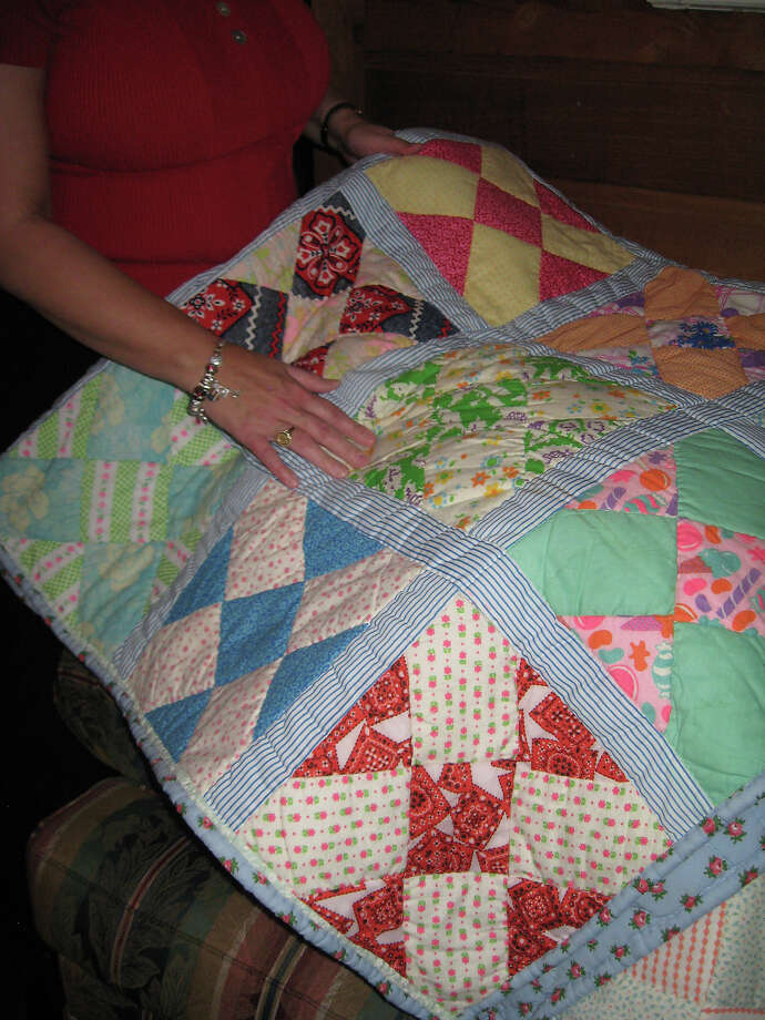 Debbie Long, a Sour Lake resident, shows one of her many quilts. Photo taken  Ioanna Makris /The Enterprise