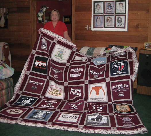Debbie Long, a Sour Lake resident, holds up her award winning quilt made from old t-shirts of her son's years at A&M. Photo taken  Ioanna Makris /The Enterprise