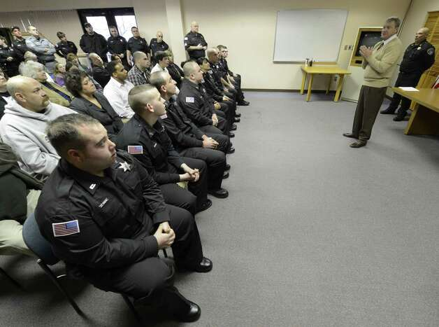 Rensselaer County Sheriff Jack Mahar the new class of 10 new corrections officers during the swearing-in ceremony at the Rensselaer County Jail in Troy, N.Y. Nov 26, 2012.   (Skip Dickstein/Times Union) Photo: SKIP DICKSTEIN / 00020243A