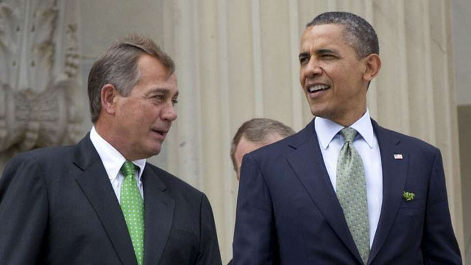House Speaker John Boehner of Ohio and President Barack Obama walk down the steps of the Capitol in
