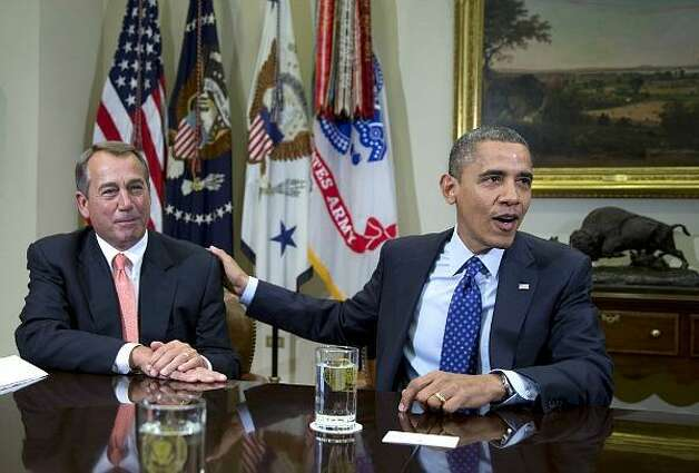President Barack Obama acknowledges House Speaker John Boehner at the White House in Washington Friday as he hosted a meeting of the congressional leadership to discuss the deficit and the economy.