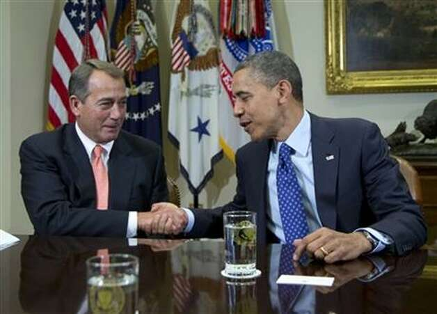 President Barack Obama shakes hands with House Speaker John Boehner of Ohio in the Roosevelt Room of the White House in Washington, Friday, Nov. 16, 2012, during a meeting to discuss the deficit and economy.