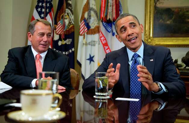 House Speaker John Boehner of Ohio watches as President Barack Obama speaks to the media in the Roosevelt Room of the White House, Friday, Nov. 16, 2012, as he hosted a meeting of the bipartisan, bicameral leadership of Congress to discuss the deficit and economy. Photo: Carolyn Kaster, AP / AP2012