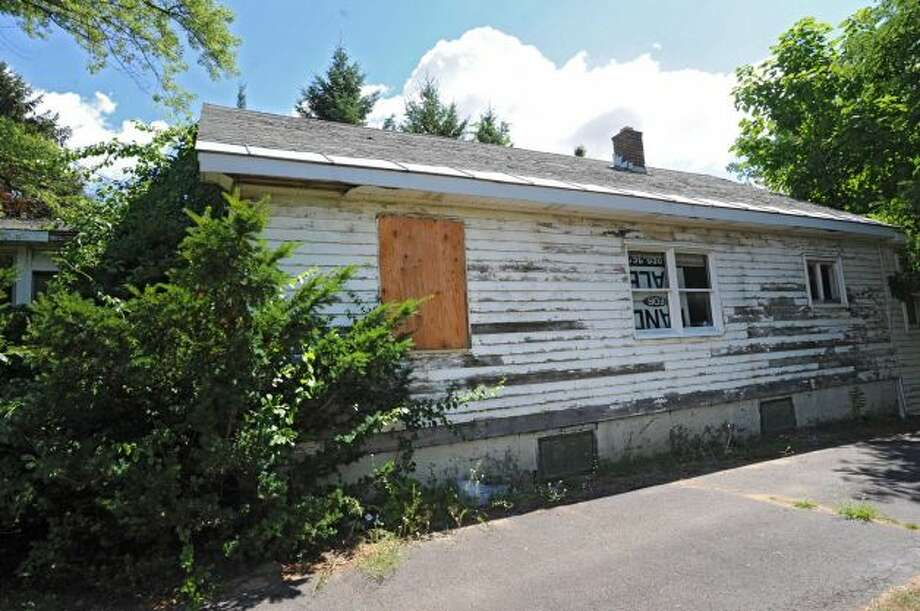 One of the vacant homes on Lehner Rd. near Crossgates Mall Monday, July 2, 2012 in Guilderland, N.Y. Pyramid Companies, the owners of Crossgates Mall, have applied to the town for permits to remove asbestos from the vacant homes. (Lori Van Buren / Times Union) Read more: http://www.timesunion.com/business/article/Crossgates-will-demolish-vacant-homes-3680112.php#ixzz1zZMZrXnn