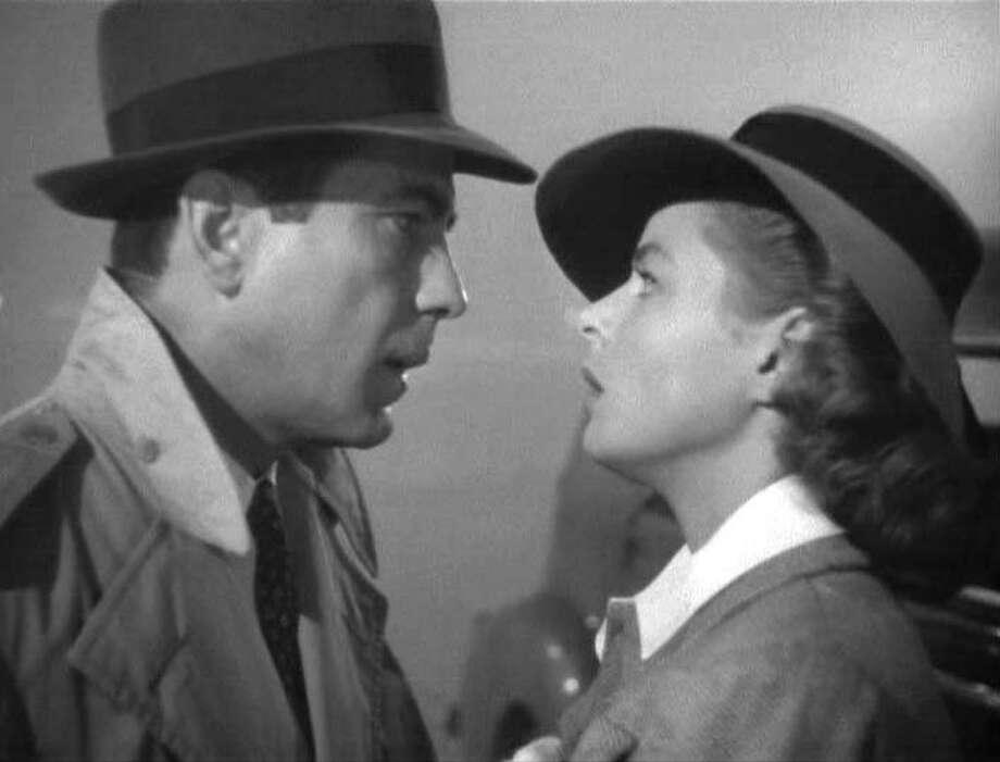 "Humphrey Bogart as ""Rick Blaine"" and Ingrid Bergman as ""Ilsa Lund"" Photo: GoneMovie.com"