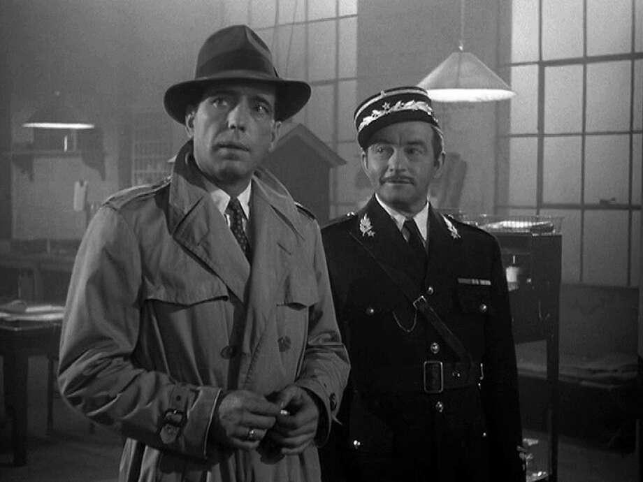 "Humphrey Bogart as ""Rick Blaine"" and Claude Rains as ""Captain Louis Renault"""