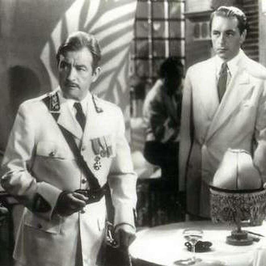 """Claude Rains as """"Captain Louis Renault"""" and Paul Henreid as """"Victor Laszlo"""""""