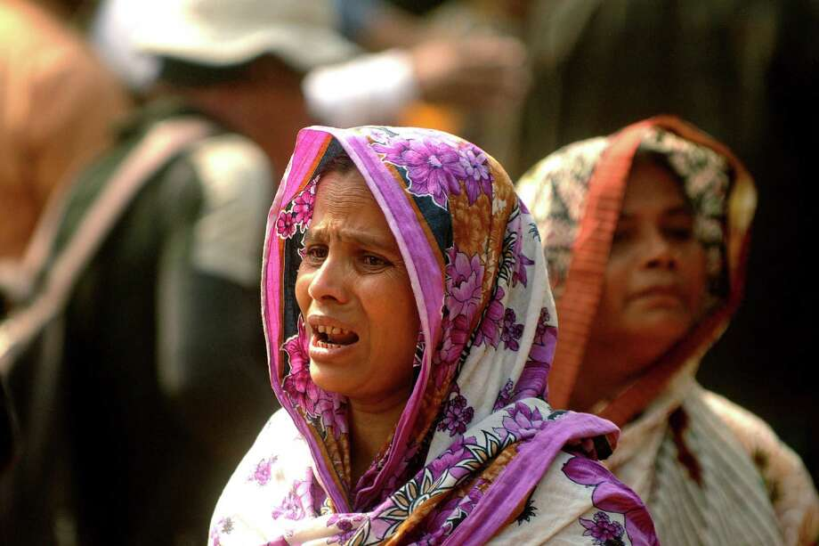 A Bangladeshi woman whose relative was killed in a fire at a garment factory cries outside a mortuary outside Dhaka, Bangladesh, Sunday, Nov. 25, 2012. At least 112 people were killed late Saturday night in a fire that raced through the multi-story garment factory just outside of Bangladesh's capital, an official said Sunday. Photo: Hasan Raza, AP / AP