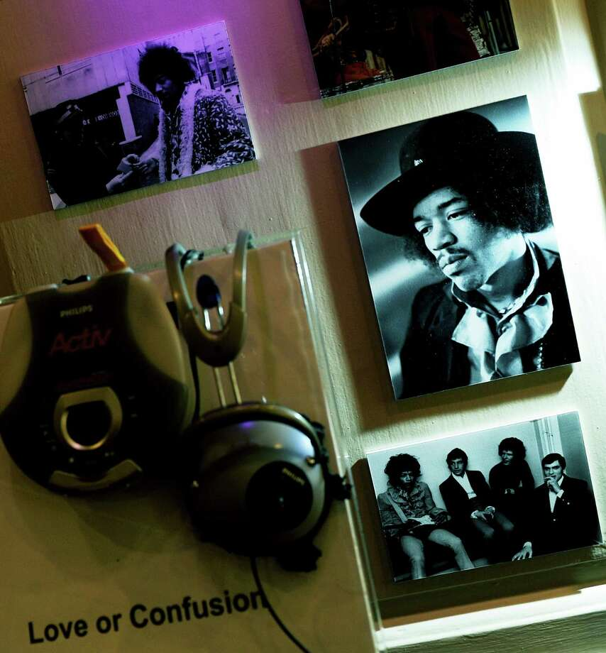 A portrait of guitarist Jimi Hendrix is seen beside other photographs of him and various musicians at an exhibition in The Handel House Museum in London Aug. 24, 2010.   AFP PHOTO/ADRIAN DENNIS Photo: ADRIAN DENNIS, Getty / 2010 AFP