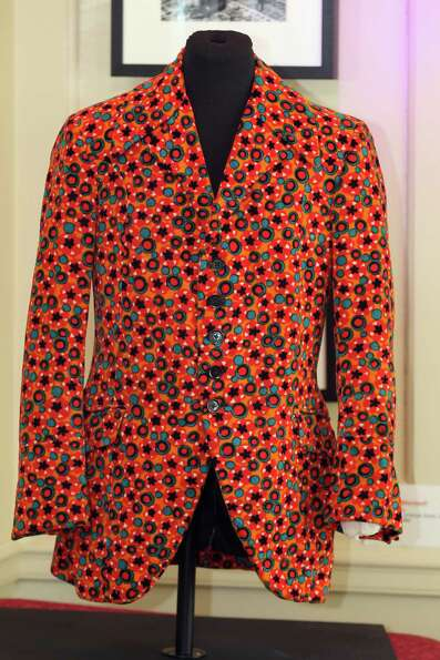An orange velvet floral print jacket, worn by the Jimi Hendrix, goes on display at the Handel Hous